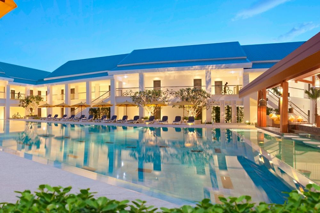 Featured image for 4-day nourish and renew yoga retreat in Phuket, Thailand with truly lovely pool picture in front of shiny new retreat resort