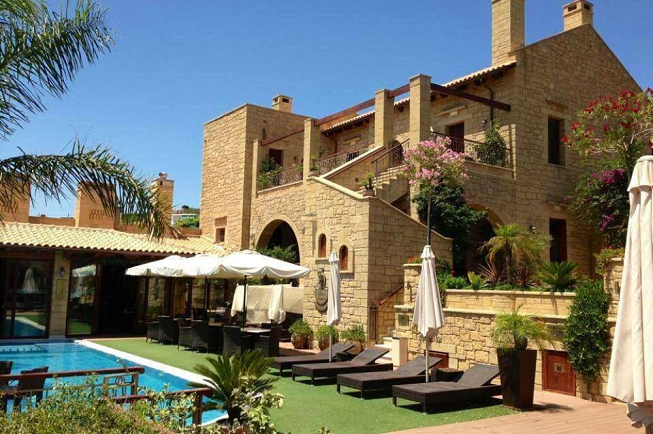 Featured image of top 30 yoga retreats for November 2017 with 5 Day Jnana Yoga, Meditation, Advaita Vedanta Retreat in Crete, Greece displaying image of the Pallazzo Lupassi Castle Suites where this magical retreat is held