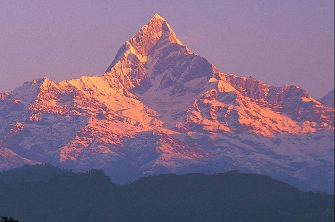 Featured image of top 30 yoga retreats for November 2017 with 8-Day Spiritual Yoga Retreat for Self-Realization in Nepal displaying a breathtaking view of the Himalayas with colors of purple, red, orange and dark-brown green