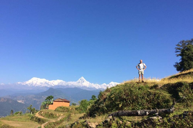 Featured image of top 30 yoga retreats for November 2017 with 8-day yoga, meditation and hiking retreat at the top of the world in Nepal with majestic view of Himalayas and a male yogi hiking at top of hill
