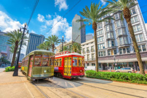 new orleans streetcars in downtown new orleans on sunny day