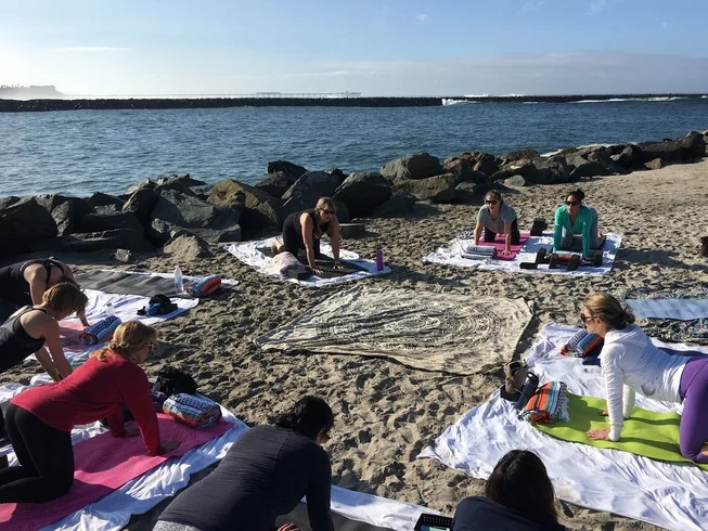 Yoga teacher training on beach on San Diego, California